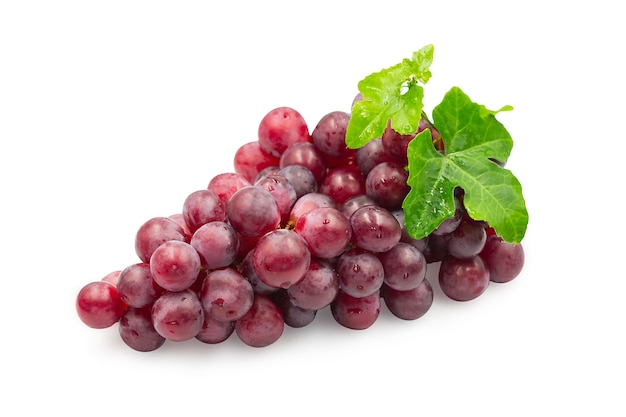 Ripe red grapes with leaves on white background