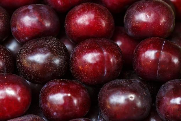 Ripe red plum fruit harvest background