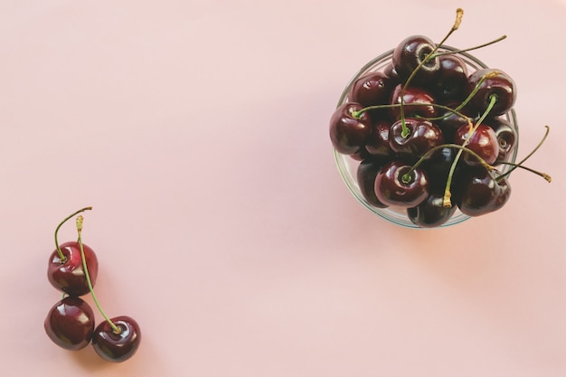 Ripe red sweet cherries. flat lay style. colorful diet and healthy food concept.