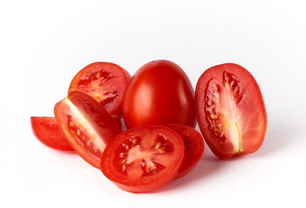 Ripe red whole tomatoes and slices