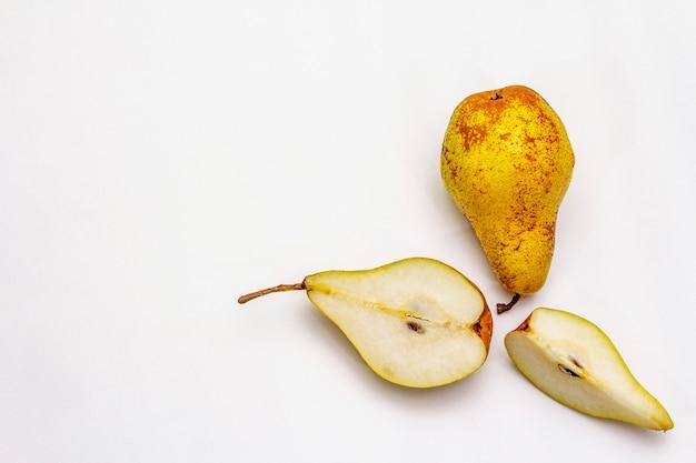 Ripe single pear. fresh whole fruit, half sliced, seeds.