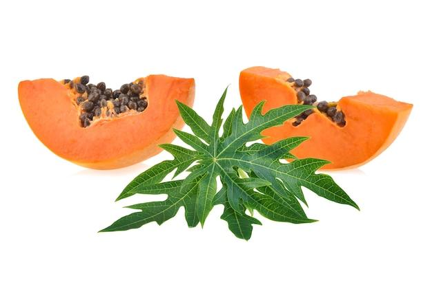 Ripe slice papaya with leaf isolated on white background.