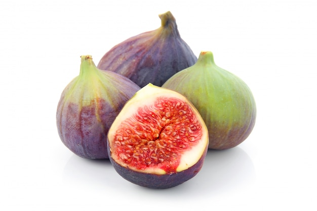 Ripe sliced purple and green fig fruit isolated