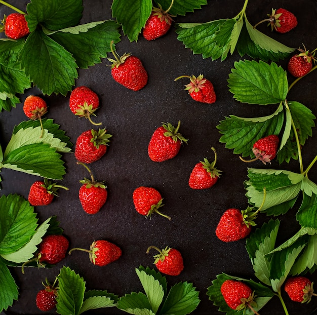 Ripe strawberries and leaves. top view