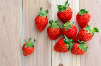 Ripe strawberries over wooden background