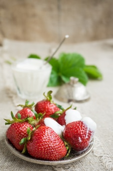 Ripe strawberries on a plate