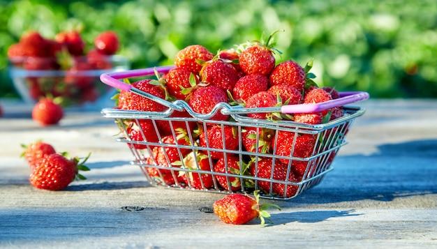 Ripe strawberries in a shop basket