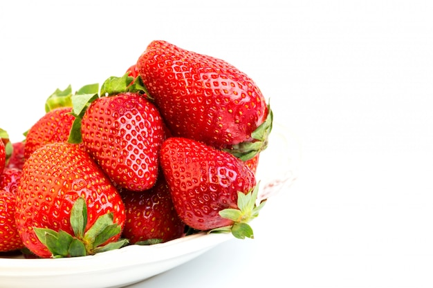 Ripe strawberries on a white background selective soft focus