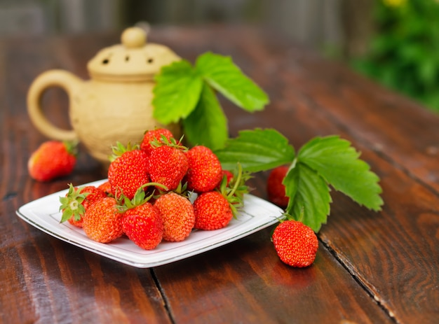 Ripe strawberry on a white plate