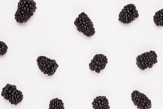 Ripe sweet blackberries on white background