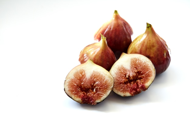 Ripe sweet figs isolated on white