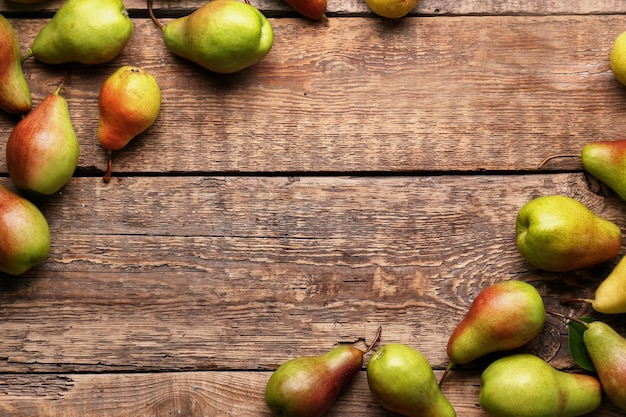 Ripe sweet pears on wooden table
