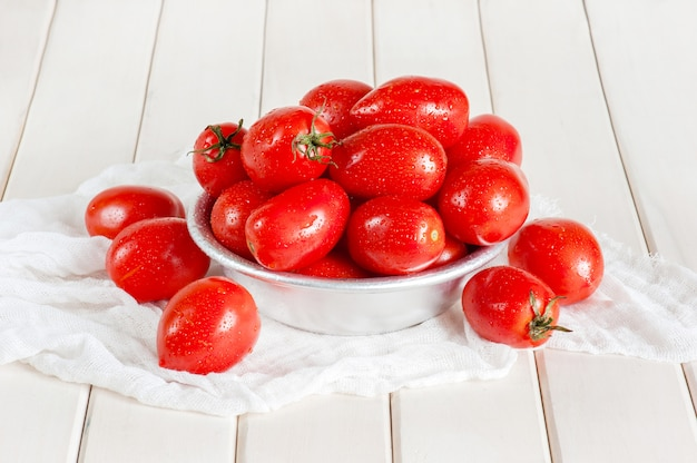 Ripe tomatoes on the white wooden table