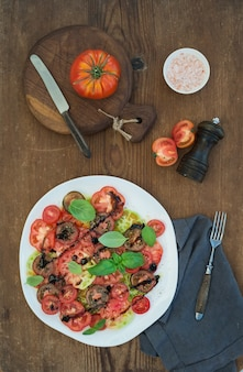 Ripe village heirloom tomato salad with olive oil, basil and spices