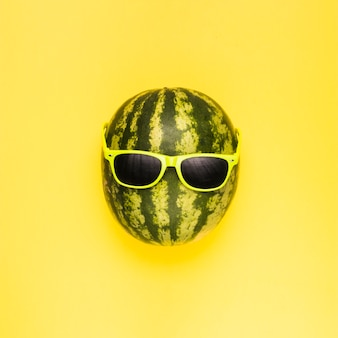 Ripe watermelon in dark sunglasses