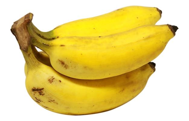 Спелый весь банан на белом фоне