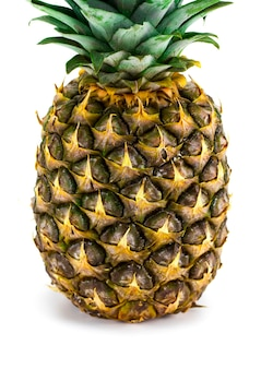 Ripe whole pineapple isolated on white background.