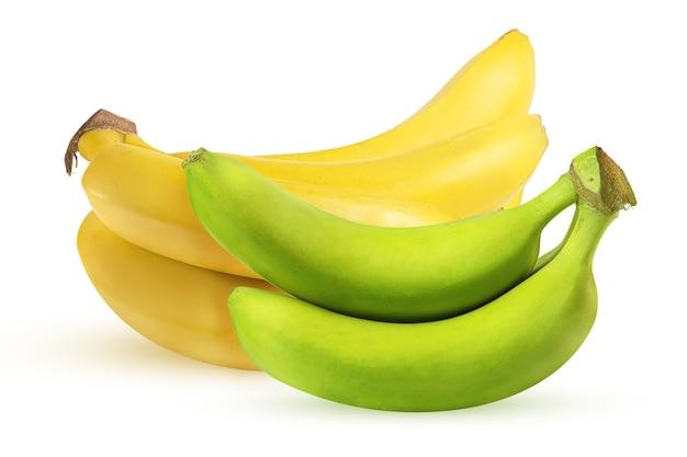 熟した黄色と緑のバナナが分離されました