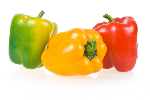 Ripe yellow, green and red paprika isolated on white background