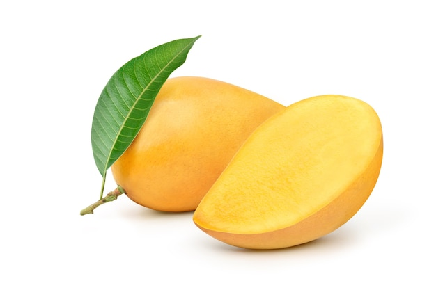 Ripe yellow mango with cut in half and green leaf isolated on white background.