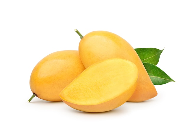 Ripe yellow mango with cut in half and green leaf isolated on white surface