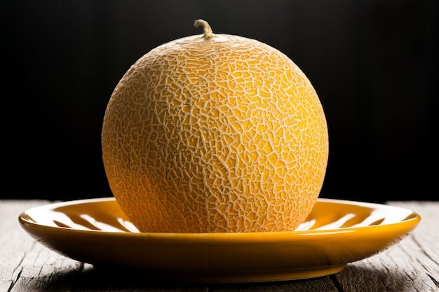 Ripe yellow melon on plate