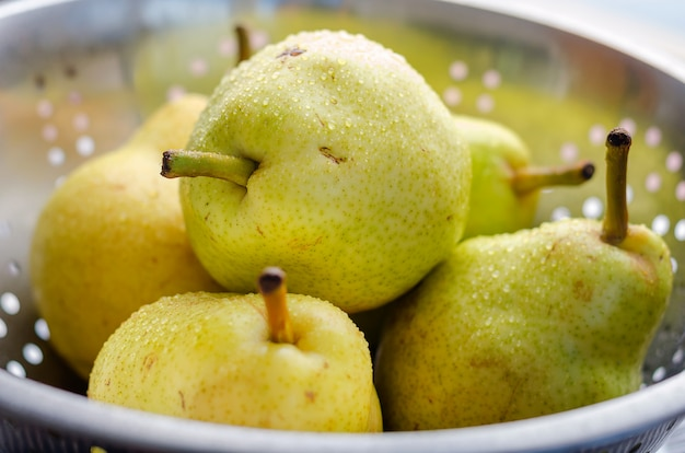 Ripe yellow pears on wooden rustic background. summer fruits, harvest.