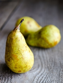 Ripe yellow pears on wooden table