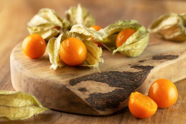 Ripe yellow physalis on wooden background