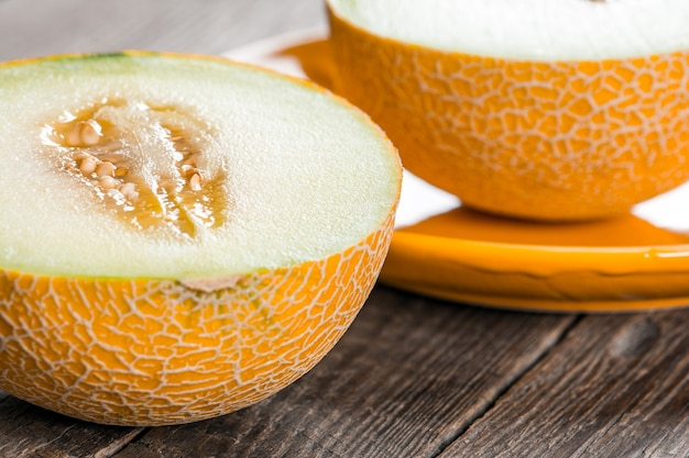 Ripe yellow sliced melon on plate
