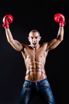 Ripped boxer in sports concept