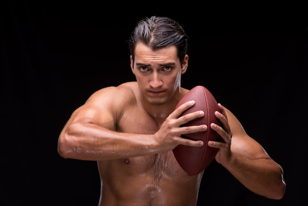 Ripped muscular man with american football