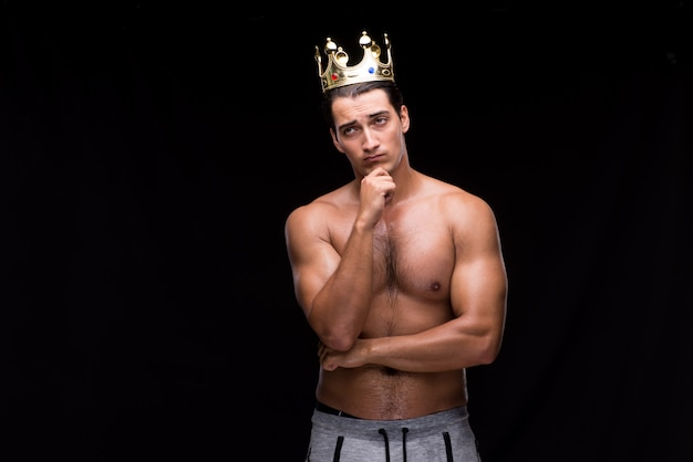 Ripped muscular man with king crown