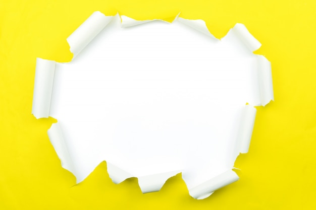Ripped open paper yellow torn paper isolated on white.
