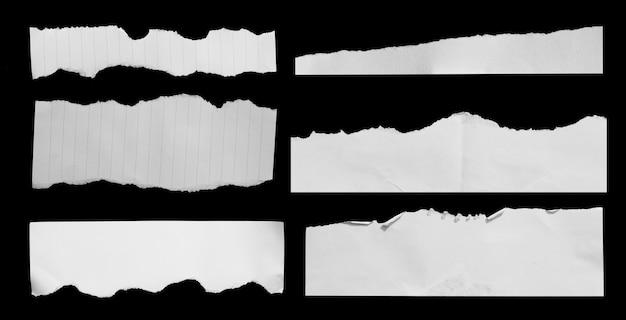 Разорванная бумага на черном фоне для рекламной копии
