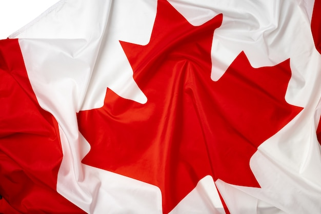 Rippled textile flag of canada close up photo