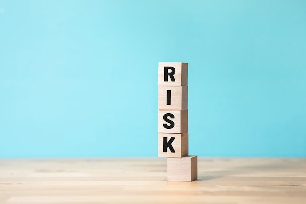 Risk and  business management concepts with text on wood box