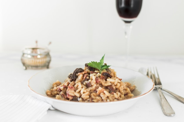 Risotto with mushrooms and coriander leaves