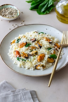 Risotto with mussels and spinach. healthy food. vegetarian food.