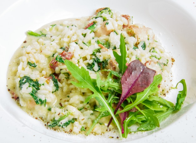 Risotto with smoked meat, spinach, parmesan cheese