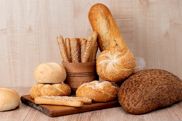 Ð¡risp bread with buns. french baguettes. fresh crispbread. bread background. different breed  on wooden background.