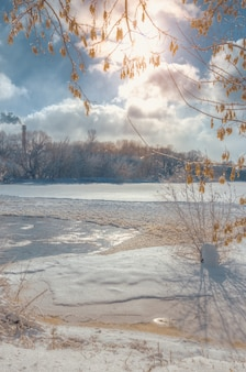 River bank in winter landscape with snow