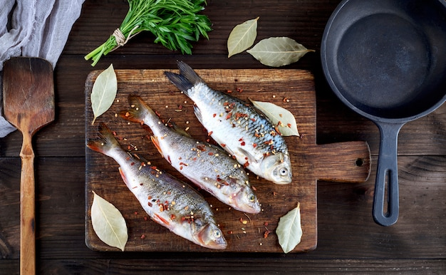 River fish on a brown wooden board