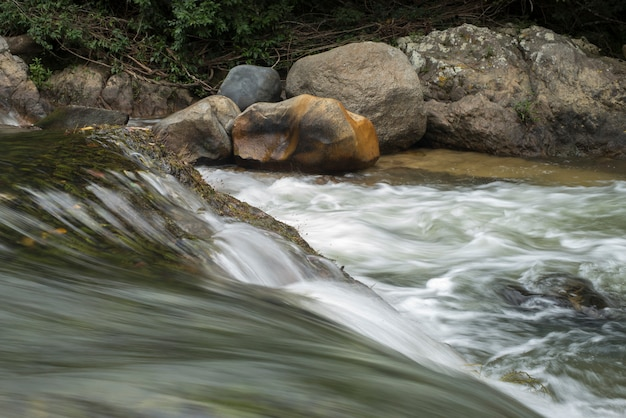 River flowing through rocks in forest, yelapa, jalisco, mexico