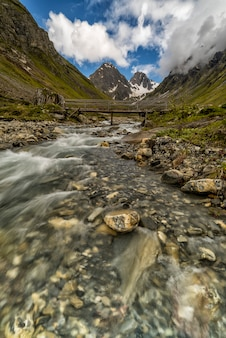 River flowing with mountains on the background in the french alps