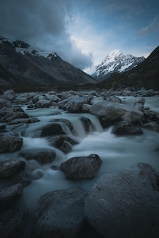 River in front of snowy mountain