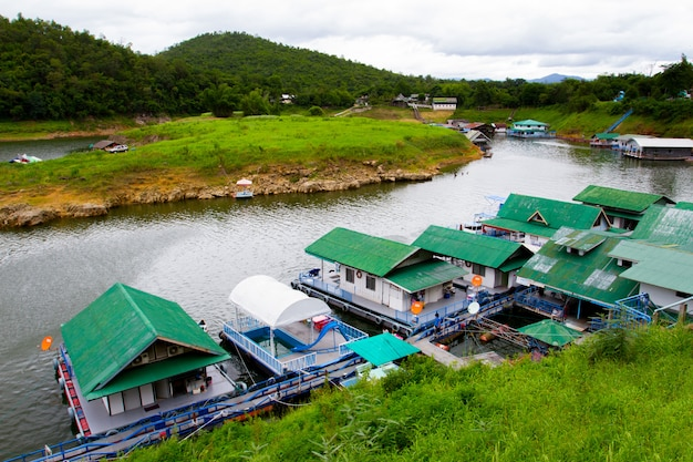 River view at the forest resort with raft house on river kwai in kanchanaburi, thailand.