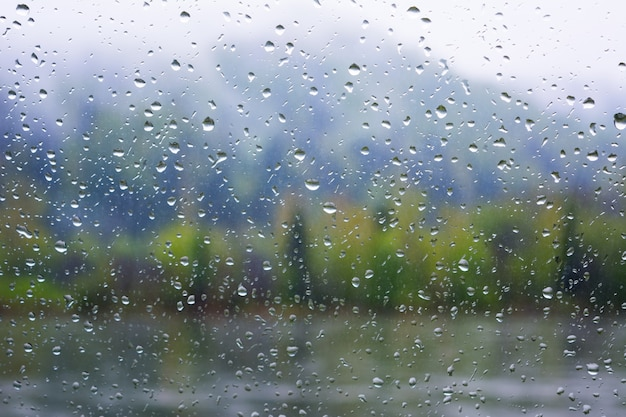 River view through window in rainy day