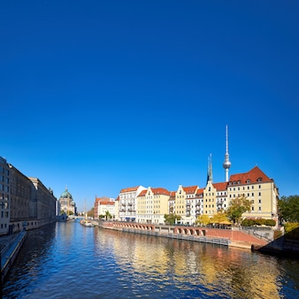 Riverside with old houses in east center of berlin, germany, text space