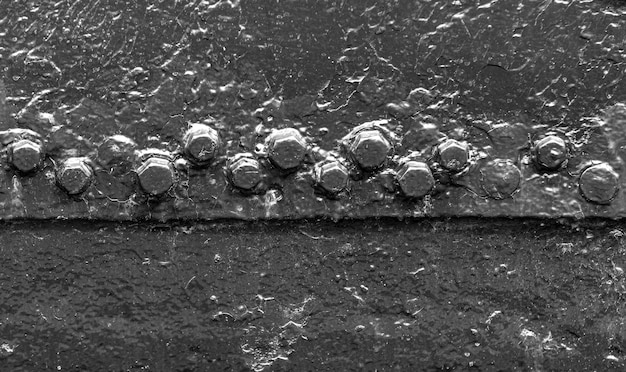 Rivet background on the old painted ship's side.
